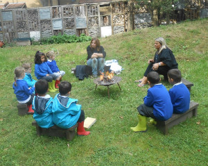 forest school round the campfire - thumb