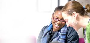 Two women laughing - thumb