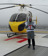 Dave with Air Ambulance on the Royal London Hospitals roof - thumb