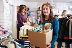 Bigstock_ 72480494 - Woman Donating Unwanted Items To Charity Shop - thumb