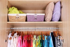 Bigstock_ 72482612 - Colorful clothes hanging in wardrobe - thumb