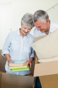 Bigstock_ 72555137 - Happy senior couple moving into new home and unpacking boxes - thumb